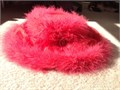 Magnificent fluffy red feather trim surrounds a medium brim ultimate ladies hat