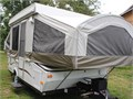 Has outside table Extra storage compartment  Has outside outletsHas an awning never used it