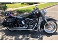 Selling my 2001 Harley Davidson Softail Deluxe Motorcycle  Black with lots of custom work Comes wi