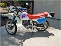 This dual sport motorcycle is in impeccable condition with less than 3000 original miles Always gar