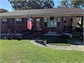 Updated 3br 15 bath brick home with detached garage and 10x12 storage building