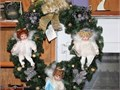 This Christmas Wreath has three beautiful dolls situated on it Each doll is estimated at 100 each