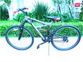 HUFFY MOUNTAIN BIKE  2 SETS OF GEARS  BLACK  RED  32 SEAT TO GROUND  36 HANDLE