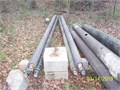 Poles are hollow rigid fiberglass 7 in at bottom and 4 12 in at top Open metal fitting on top w
