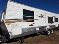 28 travel trailer rear living room with super slide queen bed in front w separate door good condi