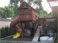Backyard Play structure Redwood complete with two Clubhouses Access Bridge Tunnel Slide Sitting