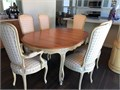 This solid wood dining set sits 6 has an extendable table and fabric upholstery In great conditio