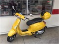 2015 Vespa LX 150 comes with a rear trunk plus mine is the European important model with rear Trun