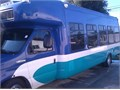 2010 Ford E-450 Shuttle bus wfront and rear ac side door with all seats in almost new condition