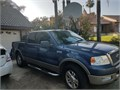 Beautiful Ford f150 lariat super crew cab Original owner Great condition all stock except for cus