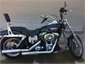 A one owner 2007 Harley Davidson Dyna Wide Glide 96 motor 6 speed trans black security system