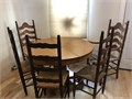 Real oak 47 round family dining table and 5 chairs all ladderback with two arm chairs In good cond