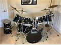 This is an AWESOME black 11 piece drum set Pearl and Pacific mix 6 Pearl 3 Pacific with a custom