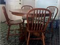 Solid Oak Round 48 dining table group  Includes 4 Oak chairs