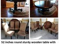 52 inches round sturdy wooden table with removable 20 inch leaf with four chairs some stains on cha