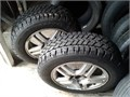 One pair Snowtrakker 195-65-15 studded winter tires mounted on 2002 Ford focus 4 bolt aluminum rims