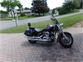 2006 Yamaha V-Star 1100 Classic with windshield highway crash bars saddlebags and a cover Always