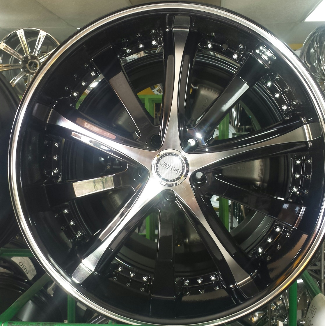 Wheels on special brand name Dcenti black with machine finish 22x9 offset13 bolt pattern 5x115 Fi