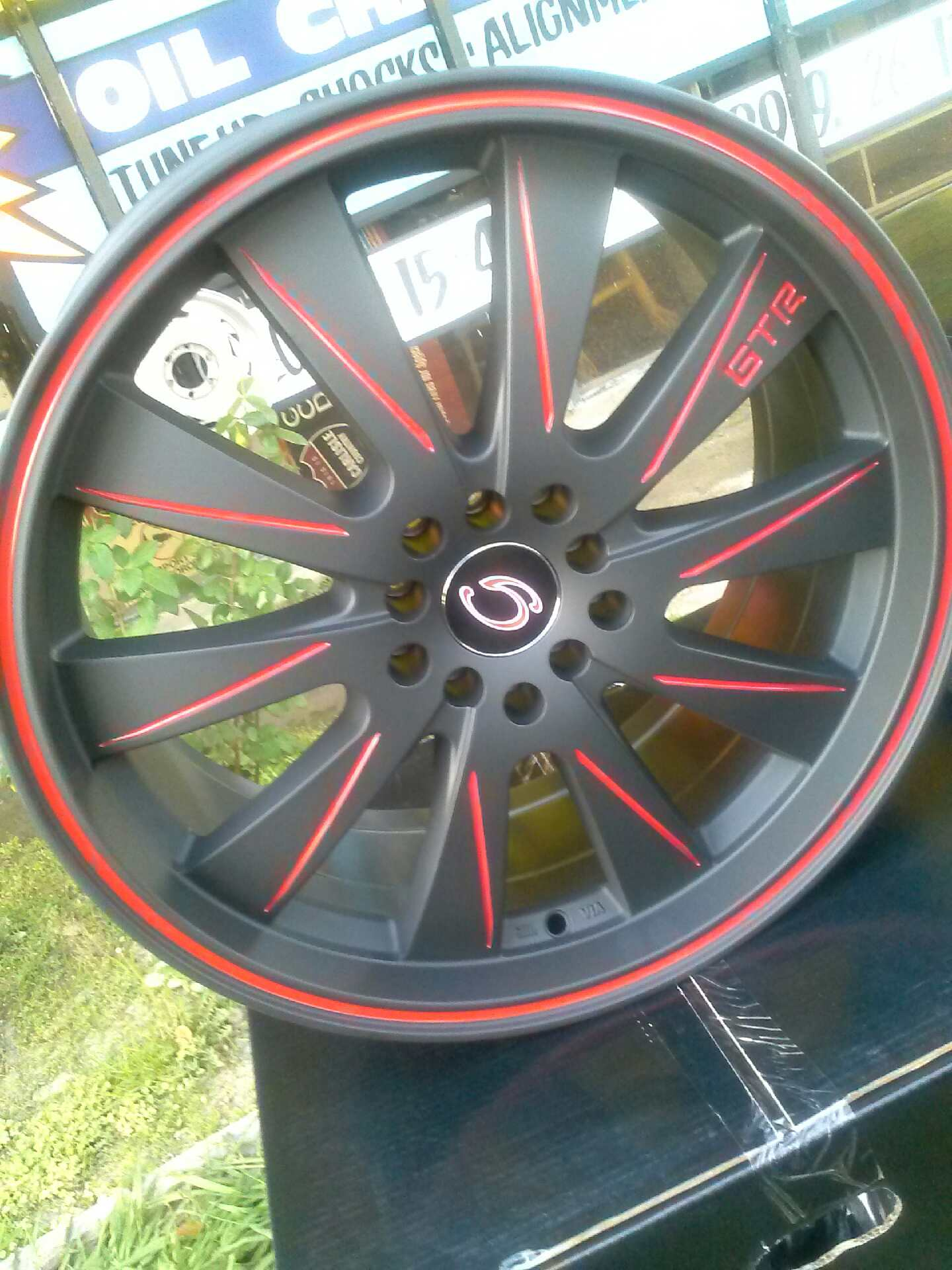 17 Matte black wheel with red lines from Gline Has a bolt pattern of 5x100114On sale for 115 ea