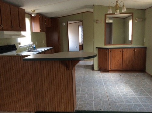 Value 32 Oakwood 14x80 singlewide Open living room and kitchen floor plan Eat in kitchen with van