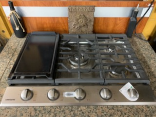Samsung 30 inch 5 burner natural gas cooktop with griddle Call Brad or Doug at 706-738-7751  Howar