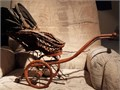Antique baby doll pram carriage stroller Circa 1920 Made of wood canvas  metal Wheels are woo