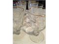 Antique etched and gold rimmed glassware set  8 water glasses 5 12 H and 3 diam and 11 compote