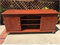 Cherry color wood veneer tvcd console with two swing-out doors for cd dvd storage In good condi