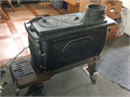 small cast iron wood stove never used 10 yrs old some surface rust 11500 814-619-5648