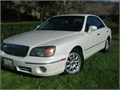 AN AMAZING CARONE OWNER  310 995-0976 This car looks an runs like a new car Pearl white mi