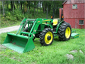 2005 John Deere 5205 4WD Tractor with a John Deere 521 loader with removable bucket and mx6 rotary