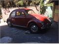 1962 Volkswagen Beetle with rebuilt 1600 engine 12-volt Extra parts wheels and original 6-volt en