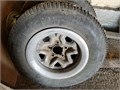 Two 14-inch rims Chevrolet S10 with studded snow tires P20570R14 432 tread for 5000  TEXT 5