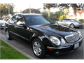 2005 Mercedes E320  2nd owner and non smoker  black on black  full power all records new tires