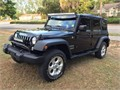 Hello I am selling my 2014 Jeep Wrangler Sport Unlimited 4x4 Its Black on Black NO ACCIDENTS It
