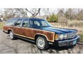 The top of the line Ford the Crown Victoria LTD Country Squire LX Woody Wagon with 3rd row seat i
