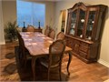 Formal dining room seats 8 with table leaf China cabinet with light and serving table that opens up