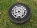 4  FORD 5 LUG Truck  SUV factory steel rims with tires with lug nuts ONLY 15 and caps 4-23565R
