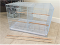 Rectangular Bird Cage with Divider24x16x16 BRAND NEWIncludes 4 cups 6 perches middle wired div