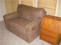 Twin sleeper sofa by Ashley mocha brown faux suede  teak side table wdrawers Spare BR perfect