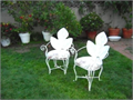 Set of 4 beautiful garden chairs with new seat upholstery light green The metal part of chairs is wh