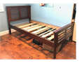 Two sets twin size wood bed frame with mattress in good condition Located in Walnut 100 per set