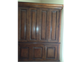 Solid wood two-piece corner cabinet in pecan finish This is a substantial piece of furniture for a