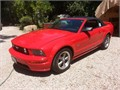 Extra clean convertible 59500 miles Red exterior w black leather interior Top in perfect condit