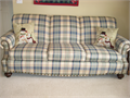 Very good condition sofa and matching chair Americana look cream blue and red  Solid constructio