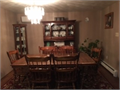 Solid oak dining room set includes 1 arm chair and 5 side chairs  The pedestal table is 72 x 42 a