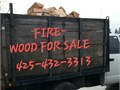 Selling firewood seasoned or green Big honest split cords Dump truck delivers burn natural wood f