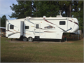 2010 North Ridge  NRF322RLT 5th wheel 3 slideouts 2 AC units luxury package fireplace 2 recline