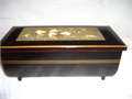 This is a 55 year old Westland Musical Jewelery Box made in Japan and painted in black lacquer wit