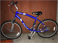 A Schwinn Searcher Mens Road Bike in great condition Has 26 wheels and suspension Comes with 2 n